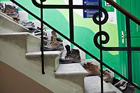 Boots lined up on stairs in hostel along the Camino de Santiago