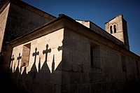 Shadows of crosses on the wall of Iglesia de Santiago, village of Barbadelo along the Camino de Santiago