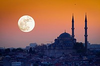 Mosque silhouetee with moon at sunset Istanbul, Turkey