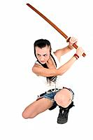 Young punk teen girl wielding a bokken a wooden Japanese sword used for practice