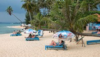 Visitors relax on sun beds Long Beach Phu Quoc Island Vietnam