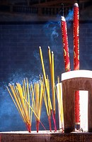 Incense sticks burning at temple in Ho Chi Minh City Vietnam