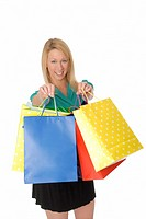 Pretty Woman Holding Up Colorful Shopping Bags