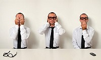 Office Etiquette - Man as Three Wise Monkeys in Workplace