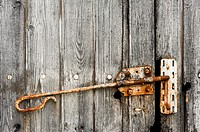 Old wooden barn door with rusty latch, Charente, France