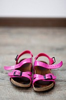 Pink sandals of a little girl