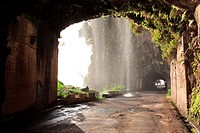 tunnel and waterfall at the old coastal road, also called the car washing street, Madeira, Portugal, Europe