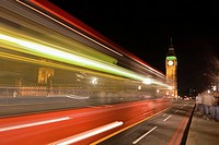Blurred bus at night with Big Ben in the background, London, England