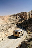 Africa, Tunisia, nr  Saket  Land Rover camper van descending into the famous narrow gorge near Saket