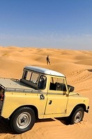 Africa, Tunisia, nr  Tembaine  Looking out for the right track  Desert tourist and his Land Rover Series 2a Truck Cab in a sandfield close to Tembaine...