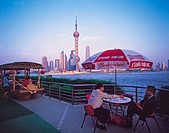 Shanghai, China, Riverside cafe Huangpu River, Pudong background
