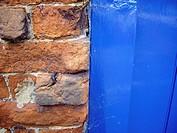 Brick wall and blue door