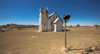 An old church with it´s steeple missing,stands forlornly deserted in the hot sem-desert sunshine.
