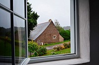 Europe, France, Bretagne, Brittany region, Boubansais, Pleugueneuc Village, Looking out the window.