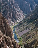 Gunnison River flows at base of steep walls formed from gneiss and schist, view from Pulpit Rock, Black Canyon of the Gunnison National Park, Colorado...