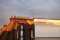 Chimneys on the top of a london´s building in the afternoon light