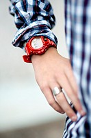 Detail of a teenager wearing a G-shock watch