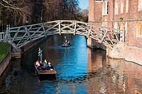 Punters go under the Mathematical bridge at Queens College Cambridge  UK