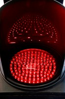 Traffic light of leds red illuminated at night indicating stop to the automobiles.