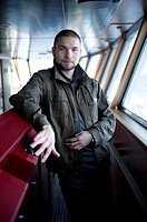 Baltic Sea near Sweden. Portrait of aRussian steering officer on the bridge of container-vessel MV Flintercape, during a journey from Rotterdam, Nethe...