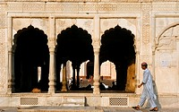 Man walking by marble pavilion in Lahore, Pakistan