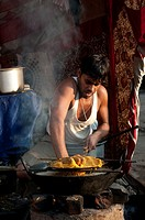 Man cooking in the street, Pushkar, Rajasthan, India