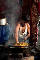 Man cooking in the street, Pushkar, Rajasthan, India