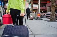 Traveling woman with luggage at the airport