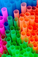 Brightly colored plastic tubes close up to form an abstract composition