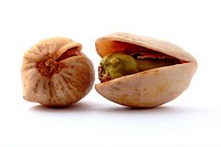 Two pistachio nuts isolated on a white background.