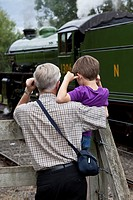 Young and old railway enthusiasts