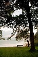 Bench on Kochelsee lake shore, Bavaria, Germany