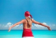 Woman with Santa´s hat on the beach, Miami, Florida, USA