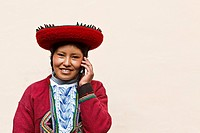 Young Peruvian Lady using a Cell Phone  Peru