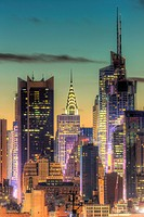 The Chrysler Building, Bank of America Tower, and other buildings near 42nd Street in New York City during morning twilight as viewed over the Hudson ...