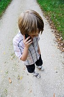 11 year old boy talking onhis mobile phone