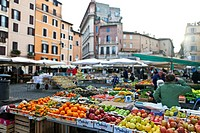 The Campo de ´Fiori translated field of flowers is a square in central Rome, in the district Parione, east of the Tiber  On the Campo takes daily exce...
