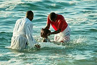 A baptism takes place early one morning in a coastal tidal pool  Cape Town, South Africa