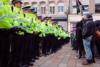 Line of Police officers confronting protest marchers, Glasgow, Scotland
