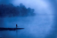 Europe, France, Var 83, Lake Saint Cassian, fisherman in the early morning