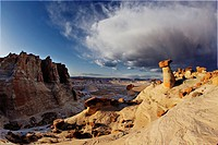 Storm clouds approaching Hoodoos in desert near Page, Arizona, USA