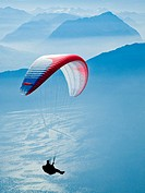 A man paragliding in the Swiss Alps near Mount Rigi