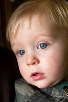 Young boy with big blue eyes