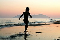 person running on beach sea at sunset near circeo, italy