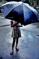 Indonesia, Bali, Girl in Rain