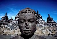 Indonesia, Java, Buddhist Ruins of Borobodur, Dyani Buddha Statue and Stuppas