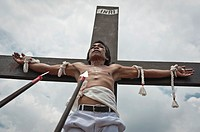 Alex nailed on the cross during the traditional crucifixions, Good Friday, San Fernando, Pampanga, Philippines
