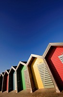 Colourful beach huts along the seafront promenade at Blyth, Northumberland, England