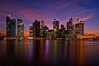 A view of the Singapore Central Business District and skyline at dusk, viewed from the Marina Bay Sands integrated resort