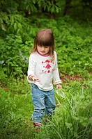 Three year old child exploring nature in Sheridan, Indiana, USA